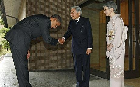 Obama politely checks Japanese Emperor Akhito's fly.