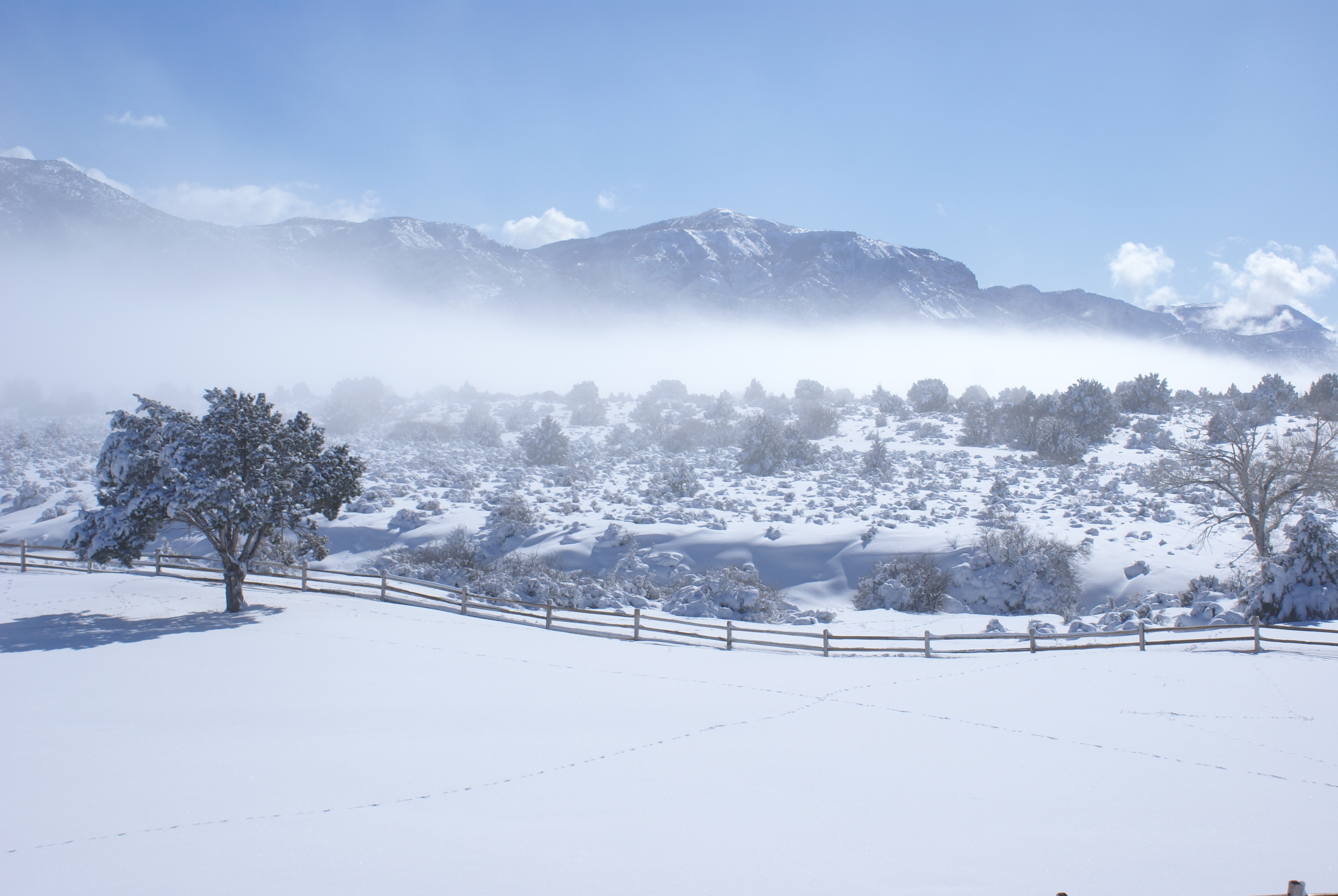 The clouds roll in before a snowstorm at our Harmony Mountain ranch near Cedar City, Utah.